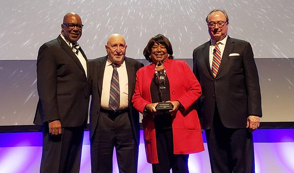 Deborah Richardson receiving the Unsung Hero Award