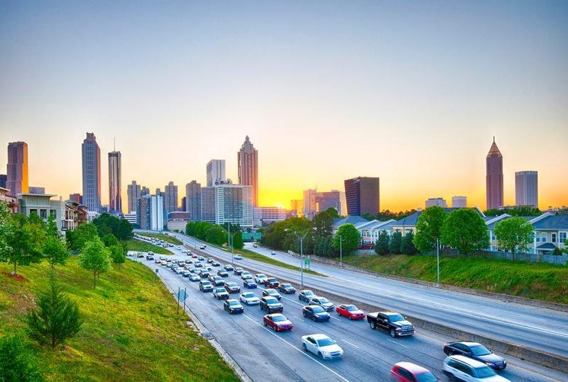 traffic with Atlanta skyline at sunset